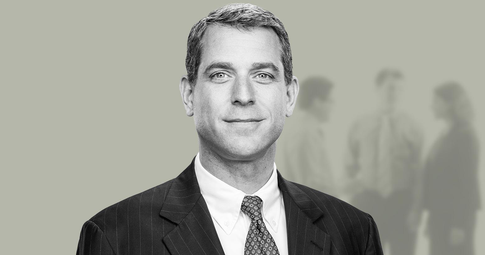 John D. Schueller